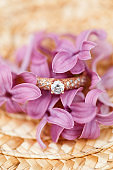 jewelry engagement ring with diamonds and spring lilac flowers