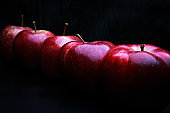 tasty juicy apples on a dark background