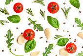 Tomato, garlic and basil isolated on white background, top view. Food pattern with fresh organic vegetables and spices. Flat lay.