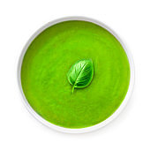 Fresh and delicious Green soup isolated on the white background. Bowl of Broccoli and Spinach soup with basil leaf'n