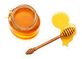 honey dipper and honey in jar isolated on white background. Natural bee Honey. Top view'n