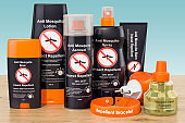 Set of insect repellent products on the wooden table