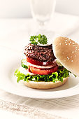 Grilled Hamburger with vegetables and a bread Roll