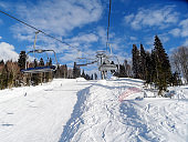 Winter sport - skiing and snowboardering in mountains.