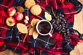 Cup of coffee Apple Cookies Cinnamon Grape Wooden background Autumn blanket Autumn lifestyle concept Top view