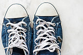 Pair of old blue sneaker  by top view