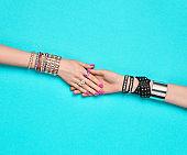 Fashion. Female hand, Trendy Jewelry. Friendship
