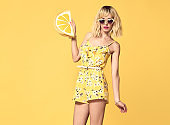 Fashion model Blond girl. Summer Yellow Outfit