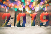 Happy New Year 2019 on Rustic Wooden Table