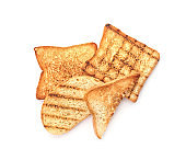 Toasted bread on white background, top view
