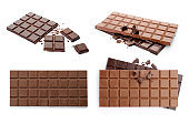 Set with different kinds of delicious chocolate on white background