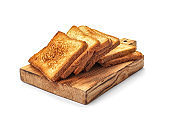 Wooden board with toasted bread on white background