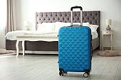 Travelling bag in hotel room