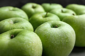 Fresh green apples with water drops, closeup