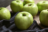 Fresh green apples on wooden table, closeup