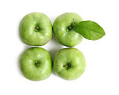 Fresh green apples on white background, top view