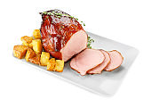 Plate with traditional honey baked ham and potatoes, isolated on white