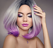 Ombre bob hair coloring woman. Beauty Portrait of blond model with short shiny purple hairstyle.Fashion amethyst jewelry set. Expensive pendant and ring.