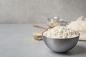 Bowl with sesame flour on table