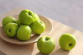 Ripe green apples on table