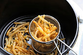 Cooking yummy french fries in chip fryer