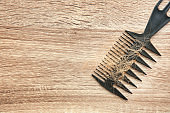 Comb with lost hair on wooden background. Alopecia problem