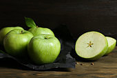 Fresh green apples on wooden table