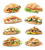 Set with fresh tasty croissant sandwiches on white background