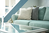 Comfortable sofa with pillows in living room