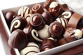 Different tasty chocolate candies, closeup