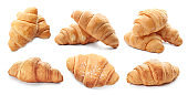 Set with fresh tasty croissants on white background