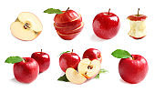 Set with delicious cut red apples on white background