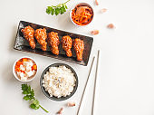 Deep fried chicken wing plate with garlic sauce in Korean style.