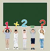 Cheerful diverse kids learning mathematics