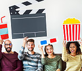 Group of diverse friends watching movie together