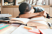 Girl hard reading and sleeping in the library.