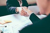 Successful businessmen handshake after good deal.