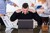 Angry Business People Pointing At Colleague