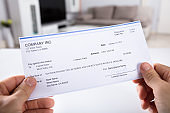 Person Holding Cheque