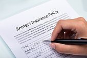 Person Filling Renters Insurance Policy Form