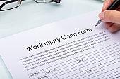 Woman Filling Work Injury Claim Form