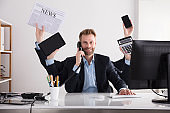 Businessman Multitasking In Office