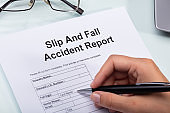 Woman Filling Slip And Fall Accident Report