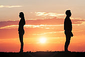Couple Silhouette Standing Away From Each Other