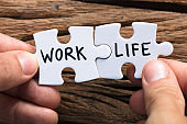 Hands Holding Work Life Matching Jigsaw Pieces