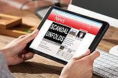 Woman Reading Scandal News On Digital Tablet