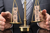 Person Protecting Justice Scale With Work And Life Balance