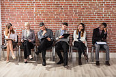 Diverse Businesspeople Waiting For Job Interview