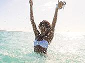 Ecstatic woman splashing water