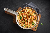 Penne pasta with tomato sauce, chicken